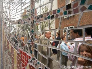 People reflected in the mirror tiles of the Save The World Club's Hundertwasser mosaic. Kingston Upon Thames, Great Britain. © 2005 Photographicon
