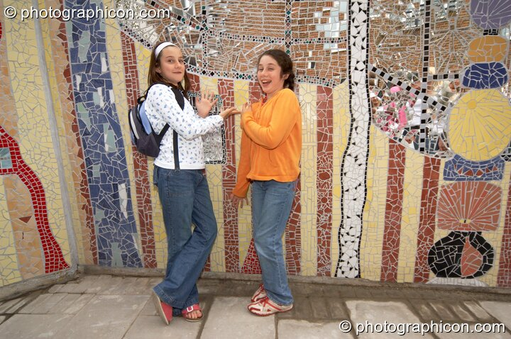 Two girls standing in front of the Save The World Club's Hundertwasser mosaic they helped make. Kingston Upon Thames, Great Britain. © 2005 Photographicon