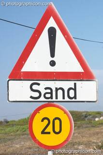 Sand warning sign a road along False Bay, Cape Town - Western Cape, South Africa. © 2005 Photographicon
