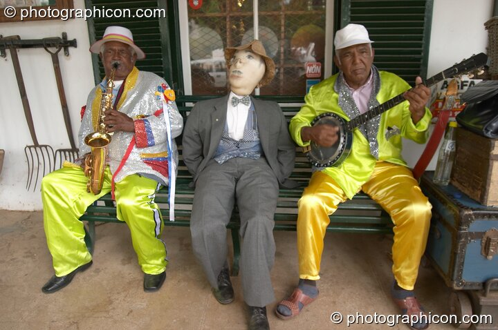 Two men and a dummy play music outside the Oom Samie Se Winkel shop, Stellenbosch - Western Cape, South Africa. © 2005 Photographicon