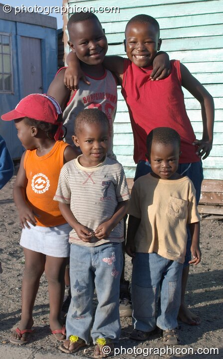 Children gather themselves on the Streets of Langa, Cape Flats, Cape Town - Western Cape, South Africa. © 2005 Photographicon