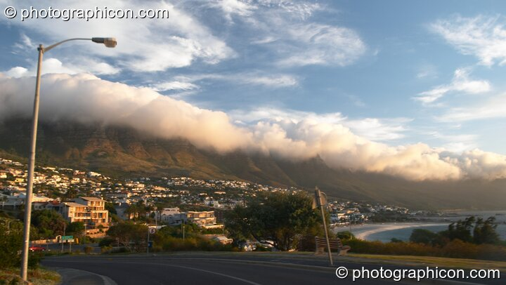 Low cloud pours over the top of Table mountain (an effect known locally as The Table Cloth at the 12 Apostles), Cape Town - Western Cape, South Africa. © 2005 Photographicon