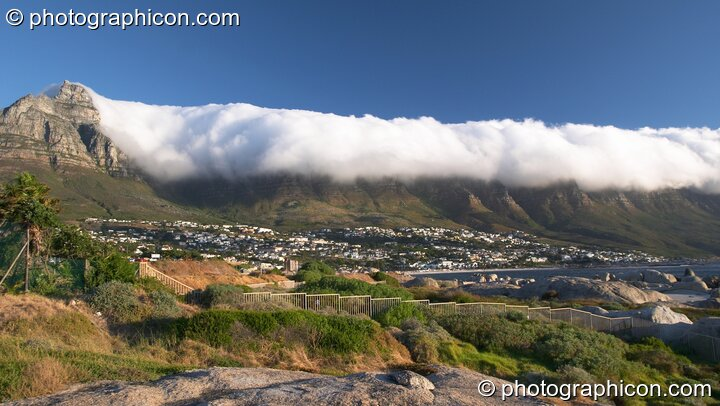 Low cloud (the Table Cloth) pours over the top of Table mountain (the 12 Apostles), Cape Town - Western Cape, South Africa. © 2005 Photographicon