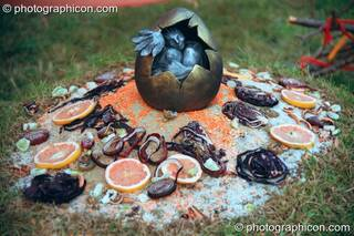 The egg shrine of a giant pheonix sculpture at Glastonbury Festival 2002. Pilton, Great Britain. © 2002 Photographicon