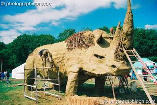 Large wicker and mud sculpture of a rhino in the Green Futures field at Glastonbury Festival 2003. Pilton, Great Britain. © 2003 Photographicon