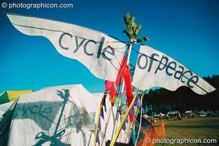 Wings with a message, attached to the top of Professor Des Kay's bicycle at Big Green Gathering 2003. Cheddar, Great Britain. © 2003 Photographicon