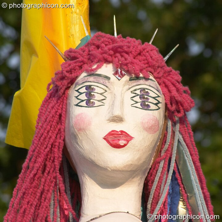 Female mannequin with pink hair and six eyes in the Green Crafts field at Glastonbury Festival 2005. Pilton, Great Britain. © 2005 Photographicon