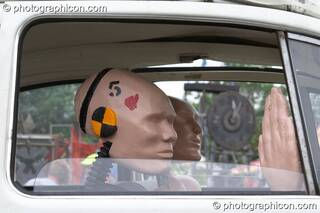 Mutoid Waste Company sculpture of a family of crash-test dummies in a VW Beetle at Glastonbury Festival 2005. Pilton, Great Britain. © 2005 Photographicon