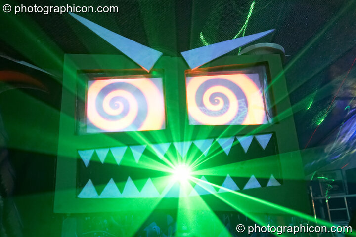 Monstrosity Labs' Garry Greenmonster (interactive stage art featuring LCD animated eyes and laser mouth) in the Monstrosity/Storm tent at Waveform Project 2007. Kenton, Exeter, Great Britain. © 2007 Photographicon