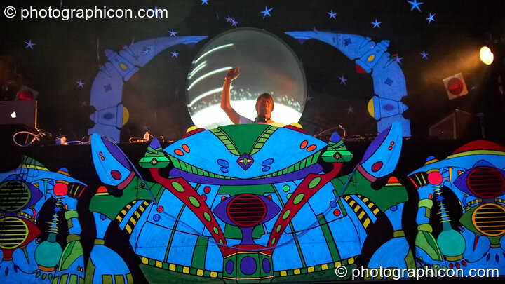 Tristan Cooke DJing at the night on the sculpted and colourfully fluorescent Origin Stage at Glade Festival 2006. Aldermaston, Great Britain. © 2006 Photographicon