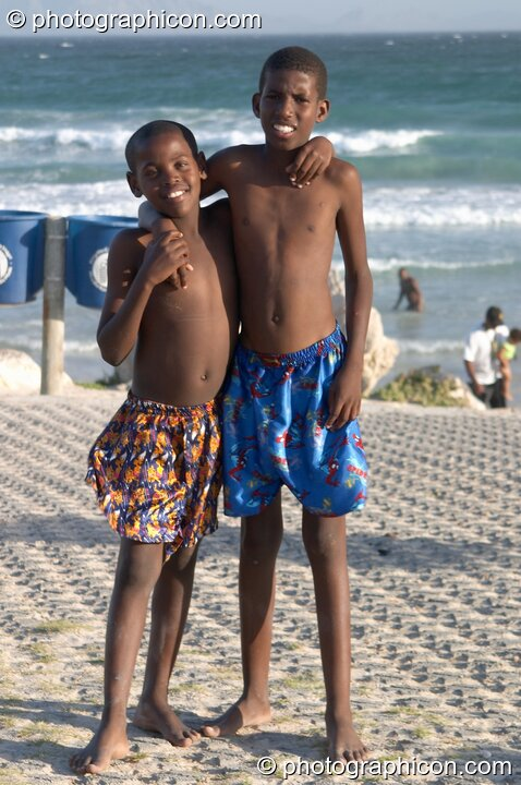 Two boys pose shoulder to shoulder on Mnandi Beach, Cape Town - Western Cape, South Africa. © 2005 Photographicon