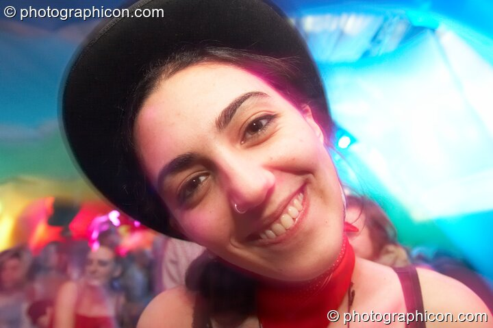 A woman in a hat cocks a smile in the Galactic Fantastic room at The Synergy Project. London, Great Britain. © 2008 Photographicon