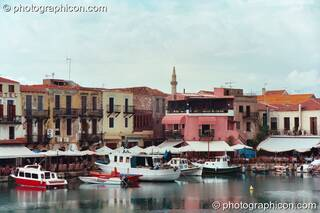 Boats and buildings reflected in the water of the harbour at Rethymno. Greece. © 2002 Photographicon