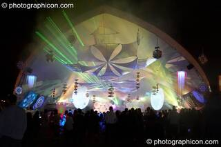 An external front view of lasers, lights, and decor in the Liquid Stage tent during a night time peformance at Glade Festival 2005. Aldermaston, Great Britain. © 2005 Photographicon