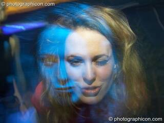 A double face exposure created by the female subject moving under blue light during a long exposure frozen by camera flash. London, Great Britain. © 2006 Photographicon