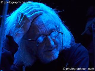 Daevid Allen sits pensively in blue light at Gong Poesy Electrique at inSpiral Lounge 21/08/2009. London, Great Britain. © 2009 Photographicon